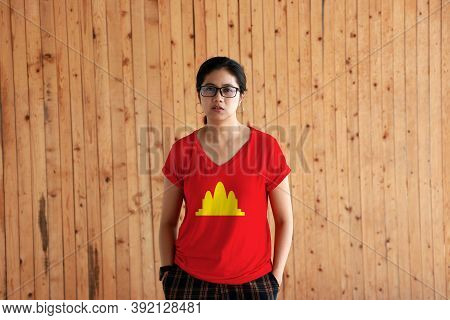 Woman Wearing Democratic Kampuchea Flag Color Shirt And Standing With Two Hands In Pant Pockets On T