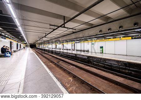 Interior Of Underground Metro Station. People On The Platform. 03.01.2020 Barcelona, Spain