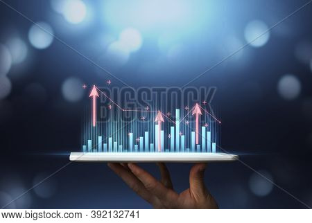Double Exposure Of Forex Chart At App Or Monitoring Company Finances. Man Holds Tablet Of Market Ana