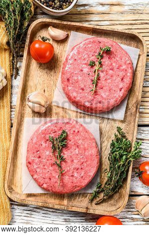 Ground Meat Patties, Raw Mince Beef. White Background. Top View