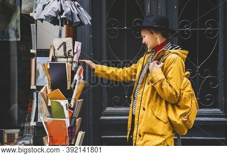 Street Look Of Young Girl In The European City. Tourist With Backpack Is Sightseeing In Old Streets