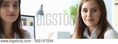 Portrait Of Gorgeous Woman Sitting At Modern Workplace And Looking At Camera With Gladness. Joyful L