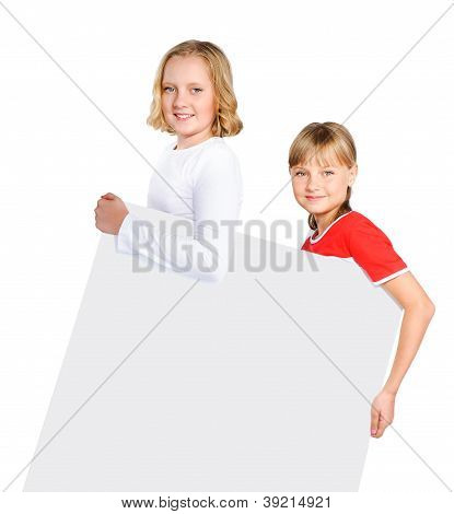 Two Smiling Preteen Girls Holding Poster Isolated Over White Background