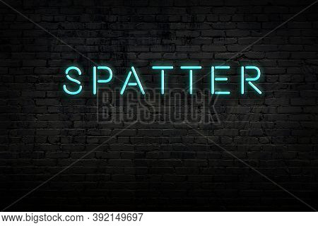 Neon Sign With Inscription Spatter Against Brick Wall. Night View