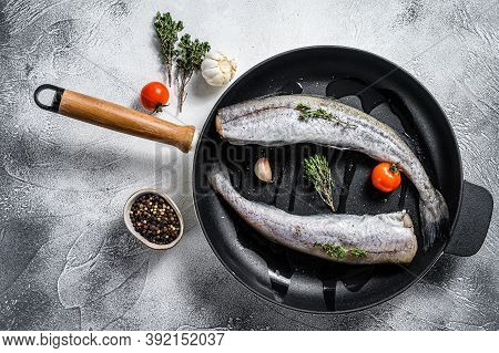 Whole Fish Pollock In A Pan. Raw Seafood. White Background. Top View