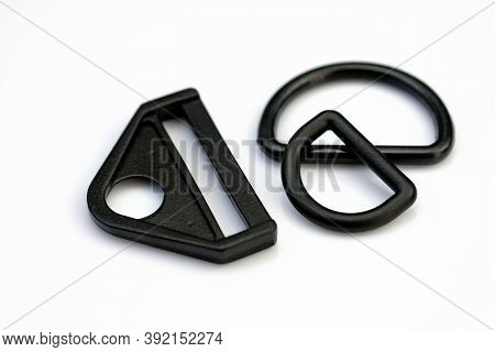 Black Plastic Accessories For Straps Of Bags, Backpacks. Plastic Black Triangle And Half Ring On A W