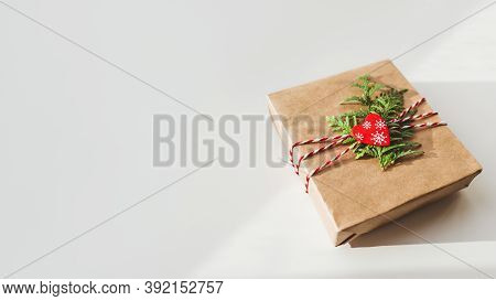 Christmas Diy Presents Wrapped In Craft Paper With Fir Tree Branches And Red Heart. Decorations On N