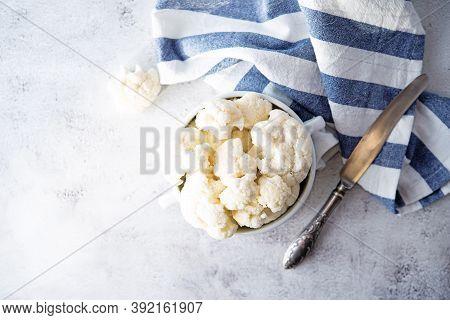 Fresh Raw Cauliflower In A White Bowl