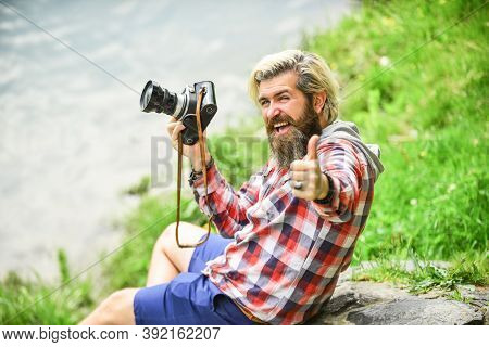 Man Bearded Hipster Photographer Hold Vintage Camera. Photographer Amateur Photographer Nature Backg