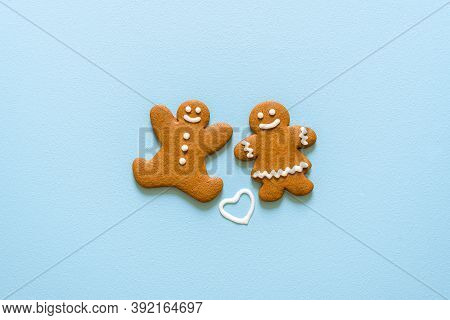Homemade Gingerbread Cookies Decorated With Icing Sugar, Isolated On A Blue Background. Christmas Co