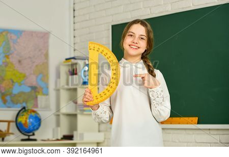 Small Child Holding Ruler For Mathematics Lesson. Science And Technology. Cute Little Schoolgirl Wit