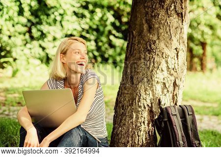 Woman Student Sit On Grass While Study. Work In Summer Park. Nature Essential Wellbeing And Ability