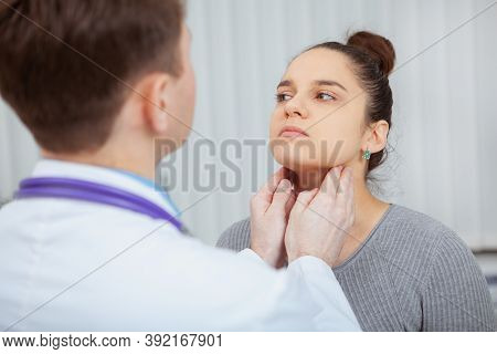 Cropped Shot Of A Young Women Having Her Neck And Throat Examined By Doctor At The Hospital. Virus,