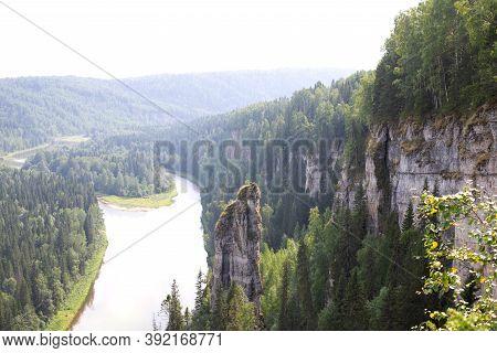Beautiful Panoramic View Of Rock Devils Finger Of Usvinsky Pillars, Ural Mountains And River Usva, P