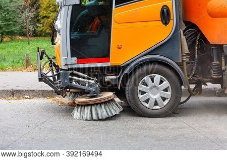 Sweeper's Rotating Front Brushes Pick Up Debris And Fallen Leaves From The Carriageway And Near The