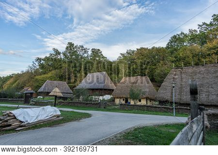 Old Romanian Traditional Houses At Astra Museum In Sibiu, Romania