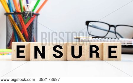 Ensure Word On Wooden Cubes, Business Concept
