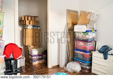 Messy Home Room With Junk And Packed Trash