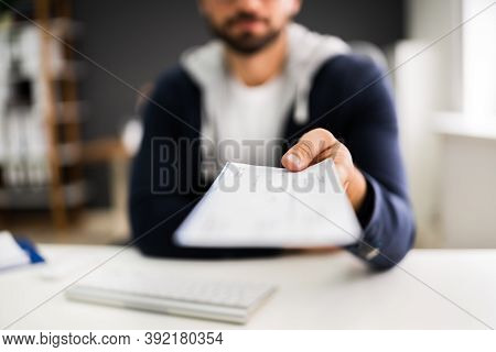 Man Giving Payroll Compensation Paycheck Or Cheque