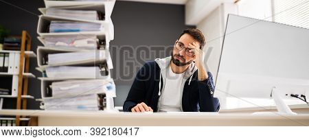 Frustrated Sad Workaholic At Computer Desk In Office