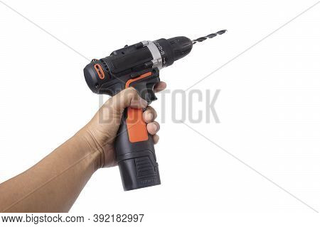 Hand Holding Handheld Electric Drill For Wood Work On White Background.