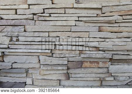 White Stone Cladding Walls Background. White Sandstone Cladding Wall Background.