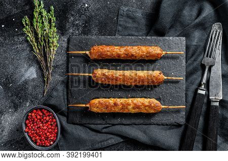 Lula Kebab. Shish Kebab On A Stick, From Ground Beef Meat. Black Background. Top View