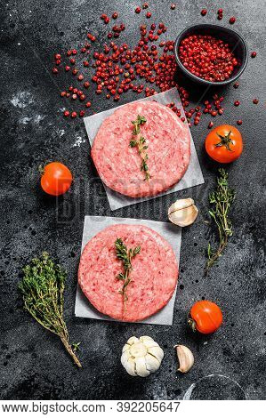Raw Mince Meat Cutlet, Ground Beef And Pork. Burger Patties. Black Background. Top View