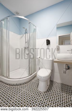 Bathroom With Shower Cabin, Sink And Basin. Modern Apartment