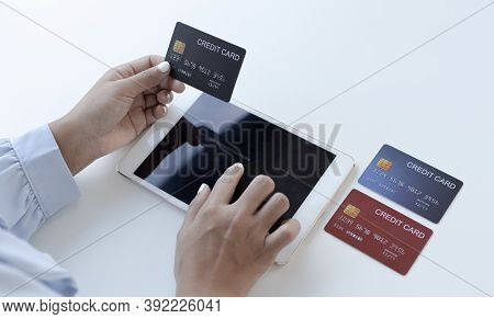Women use Tablet to register online purchases using credit card payments, Convenience in the world o