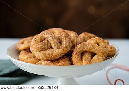 Pretzel Cookies With Sugar On A Christmas Background. Sugar Cookies.