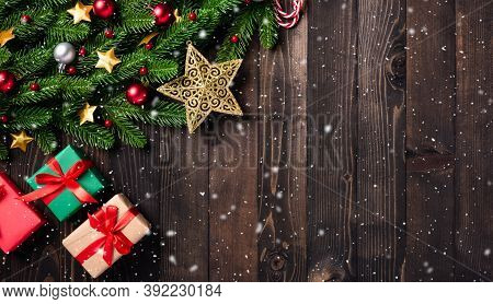 Christmas Holiday Garland Border, Top View Flat Lay Of Tree Fir Branches, And Xmas Ornament Bauble D