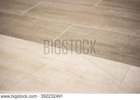 Background Of Porcelain Stoneware In Two Shades Of Light Brown Wood, Blurred Focus.