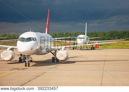 Aircraft Maintenance Parked In The Open Air Airport, Engines In Covers Repair And Mechanics Check Te