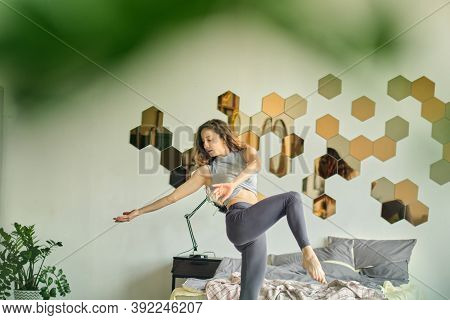Graceful Woman Dances In Her House Presenting Herself On Stage. Happy Woman Dance Enjoy Leisure At H