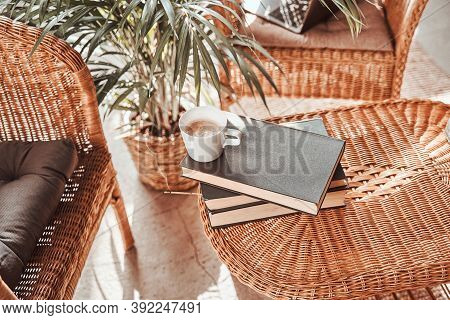 Comfortable Living Room For Solitude And Relaxation In Daytime With Bamboo Chairs And Table With Boo