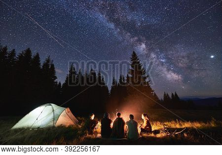 Evening Summer Camping, Spruce Forest On Background, Sky With Falling Stars And Milky Way. Group Of