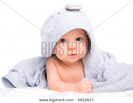 Baby In badhanddoek