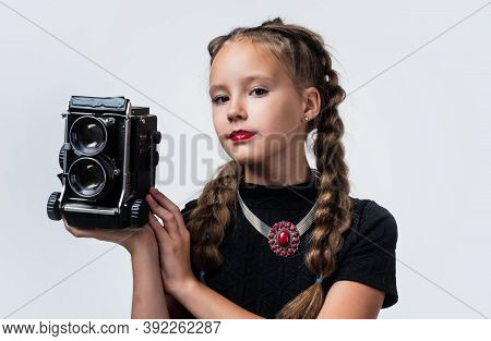 Photo Studio. Cheerful Girl With Retro Look Isolated On White. Kid Vintage Fashion. Child Take Photo