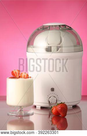 Homemade Machine To Make Yogurt, With Glass Of Yogurt And Strawberries