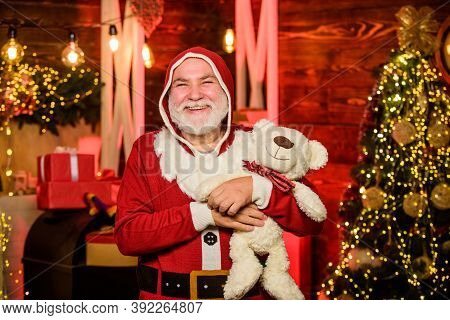 Kind Grandpa With Soft Toys. Christmas Decoration. Charity And Kindness. Lovely Hug. Santa Claus. Ma