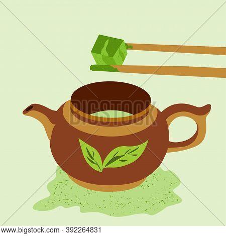 Teapot With Matcha Tea. Bamboo Sticks Hold A Cube Of Matcha Tea. Japanese Ceremony With Matcha. Flat