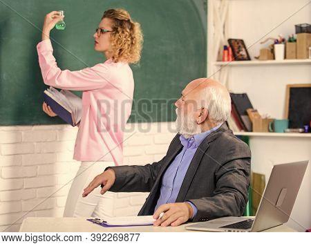 Discussion. College Tutor. Senior Teacher And Woman At School Lesson. Pass Exam. Teachers Room. Stud