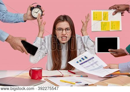 Peevish Woman Holds Hands In Disgust, Being Overwhelmed With Much Work, Feels Pressure From Colleagu