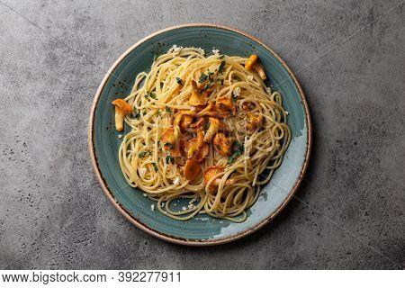 Pasta Spaghetti With Wild Forest Mushrooms Chanterelles On Plate. Seasonal Autumn Dish On Rustic Con