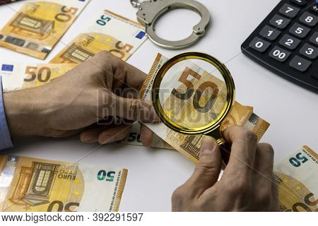 Financial Crime And Money Laundering Investigation Concept. Investigator Investigate Evidences With