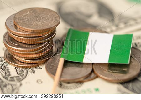 Stack Of Coins With Nigeria Flag On White Background.