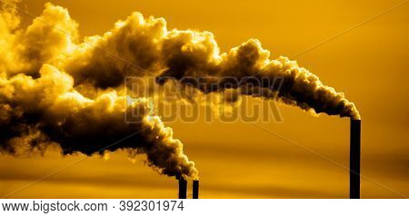 Pollution and smoke from chimneys of factory or power plant