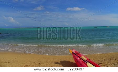 Kayak on shore of tropical beach