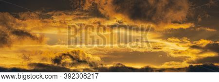 Panorama Dramatic Clouds Illuminated Rising Of Sun In Sky To Change Weather. Natural Meteorology Bac